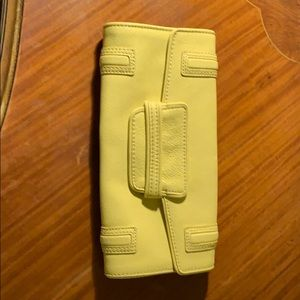 BCBG MaxAzria light yellow clutch